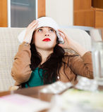 Sad young woman having headache Stock Photos