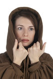 Sad young woman holding her hood. Isolated on white background Royalty Free Stock Image