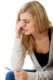 Sad young woman holding pregnancy test Royalty Free Stock Photos