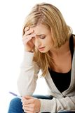 Sad young woman holding pregnancy test Royalty Free Stock Photo