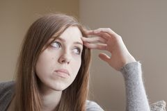 Sad young woman at home Royalty Free Stock Image