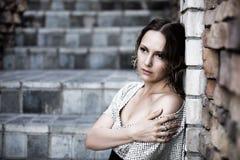 Sad beautiful woman at the wall Stock Photo