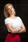Young blond fashion woman daydreaming Stock Photography
