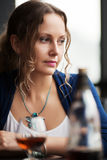 Sad young woman looking down Stock Photo