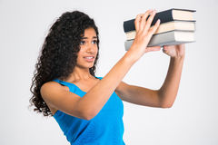 Sad young woman looking on many books Royalty Free Stock Images