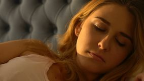Sad young woman lying in bed and crying, feeling lonely and abandoned, divorce stock footage