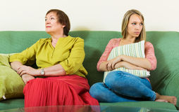 Sad young woman and   mother after conflict Royalty Free Stock Images
