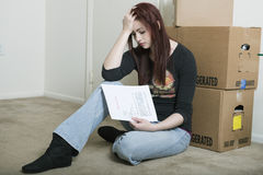 Sad young woman moving out - eviction Stock Image