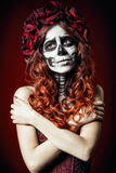 Sad young woman with muertos makeup (sugar skull) royalty free stock photo