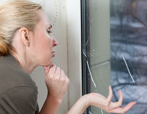 The sad young woman near a window Royalty Free Stock Photography