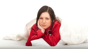 Sad young woman in red pajamas Stock Photos