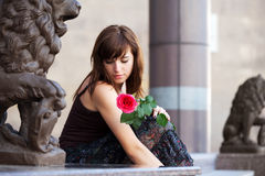 Sad young woman with a red rose Stock Images