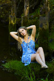 Sad young woman relaxing on nature. Royalty Free Stock Photo