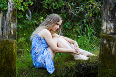 Sad young woman relaxing on nature Stock Photo