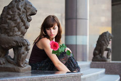 Sad young woman with a rose Stock Photos