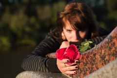 Sad young woman with a rose Royalty Free Stock Photo