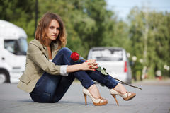 Sad young woman with a rose Royalty Free Stock Photography
