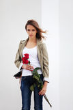 Sad young woman with a roses Royalty Free Stock Image