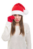 Sad young woman with Santa hat Royalty Free Stock Image