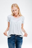 Sad young woman showing empty pockets Royalty Free Stock Image