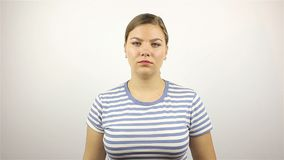 Sad young woman showing thumbs down. On white Background stock footage