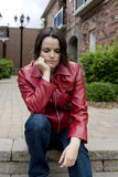 Sad Young Woman Sitting Outside Royalty Free Stock Photos