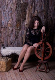 Sad young woman with a spinning wheel Royalty Free Stock Images