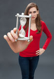 Sad young woman standing with hands on hips to face time stock photos