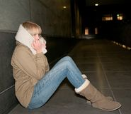 Sad young woman on the street royalty free stock photography
