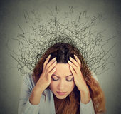 Sad young woman with worried stressed face expression and brain melting into lines Stock Image