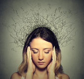 Sad young woman with worried stressed face expression and brain melting into lines Stock Photo