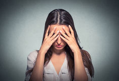 Sad young woman with worried stressed face expression Royalty Free Stock Image