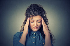 Sad young woman with worried stressed face expression having headache Royalty Free Stock Photography