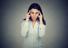 Sad young woman with worried stressed face expression having headache Royalty Free Stock Image