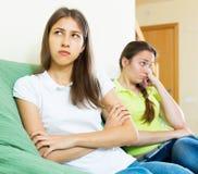 Sad young women looking away Stock Image