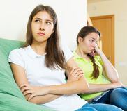 Sad young women looking away. Sad adult women looking away after conflict at home Royalty Free Stock Images