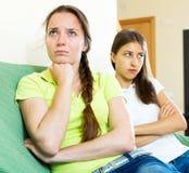 Sad young women looking away. Portrait depressed young women looking away after conflict at home Royalty Free Stock Photos