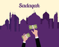 Sadaqah concept moslem islam give money with hand view from top with mosque background Stock Image