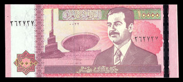 Saddam Hussein on an old Iraq banknote. Engraved portrait of  Saddam Hussein on an old Iraq banknote Royalty Free Stock Photography