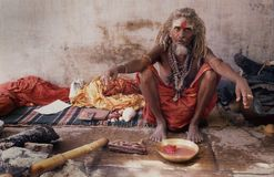 BANARAS: Saddhu in front of the Jnana Vapi mosque. Many ascetics sadhu-s live in the places of pilgrimage everywhere in India. But who penetrate the heart of a Stock Photo