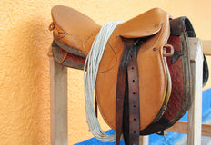 Saddle. Horse saddle on wooden bench stock image