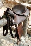Saddle. Horse on the fence Stock Photo