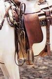 Saddle. On a white horse Royalty Free Stock Photos