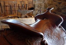 Saddle. Leather saddle in a barn Royalty Free Stock Images