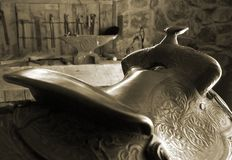 Saddle. Old saddle in a barn Royalty Free Stock Photography