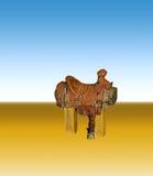 Saddle against blue desert sky. Stock Photos
