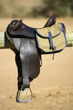 Saddle and bag. A vertical close up of horse riding gear, including a saddle and bag, in full sunlight Stock Photos