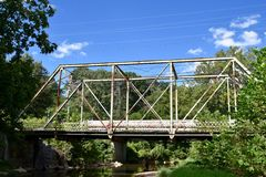Saddle Barn Road Bridge. This is a Summer picture of the Saddle a Barn Road Bridge over Leatherwood Creek located in Bedford, Indiana in Lawrence County. This Stock Photos