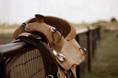 Saddle on a fence Royalty Free Stock Image