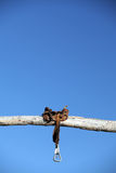 Saddle on a post. Saddle on a wooden post against clear blue sky Royalty Free Stock Image